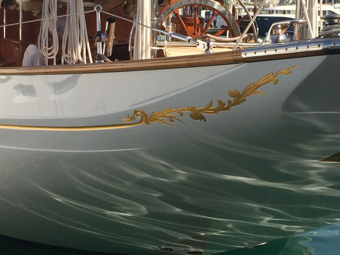 Adela´s cove stripe running into carving work at the stern.